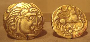 Gold stater of the Gaulish Parisii c.1stC BCE. The horse has a human face, and the charioteer appears female. The image is warlike.