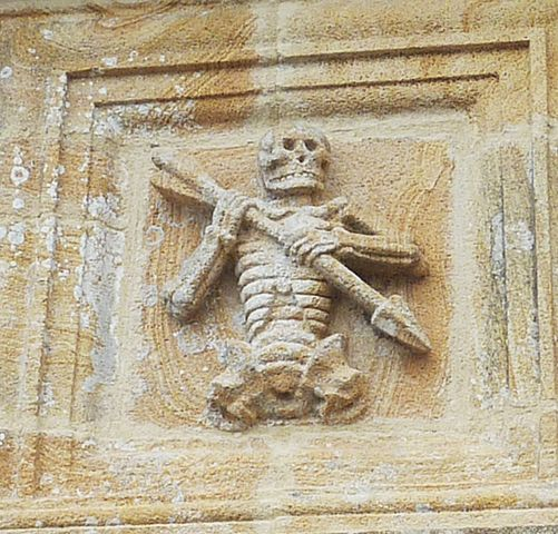 Ankou, depicted on a carving at the ossuary of the chapel of St Joseph at Ploudiry, Brittany.