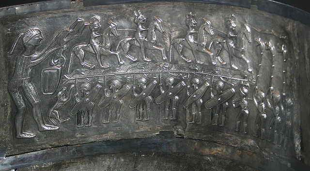 The 'warrior' panel from the interior of the cauldron. Note the branch between the warriors - the flowers look like Henbane. Photo: Malene Thyssen