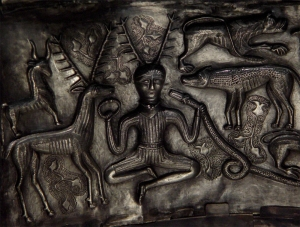 The 'visionary' man holding a torc and serpent (Gundestrup cauldron - late Celtic iron age). Compare this image to the Delphian tetradrachm above...