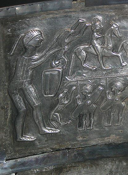 Interior panel from the late Iron Age Gundestrup cauldron depicting a giant warrior rejuvenating soldiers in some kind of vessel, making them into mounted  knights.