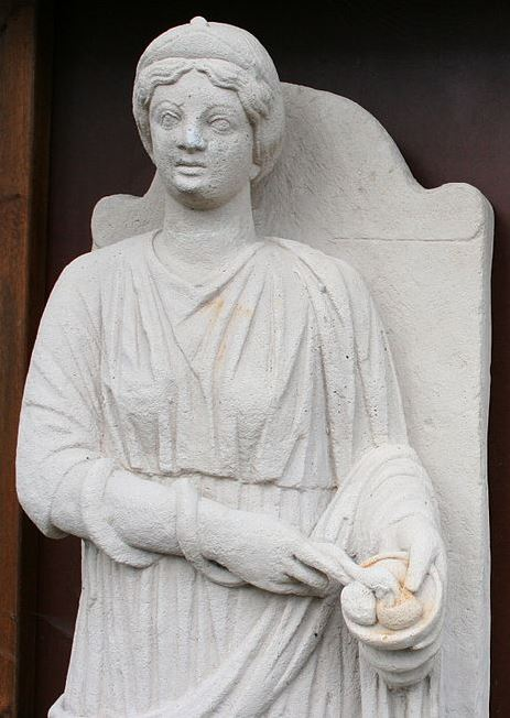 The Sirona statue from the temple discovered at Hochscheid, Moselle, Germany. Note the snake coiled on her arm, eating from a patera of three eggs.