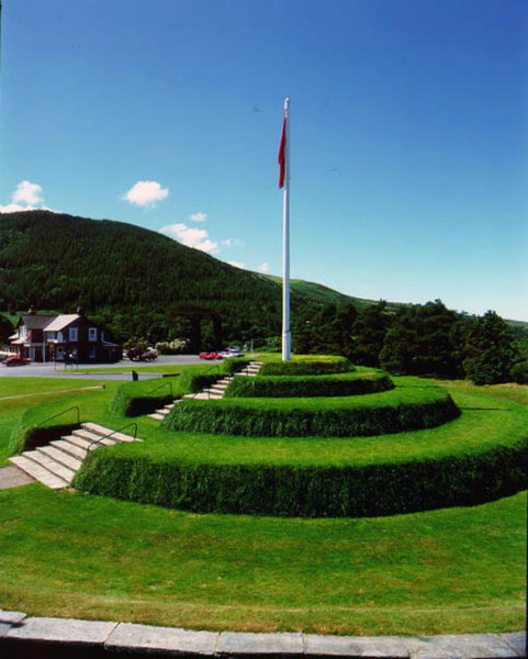 The Tynwald Hill in St John's, Isle of Man. Slieu Whallian is the mountain in the background - it is the terminal peak on the ridge descending from South Barrule, which is cited in Manx legend as home of the god Manannan.