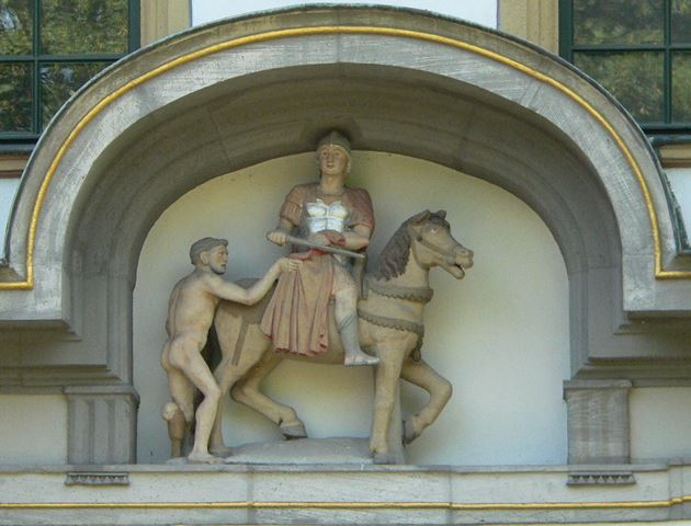 A German statue of St Martin donating his cloak to the poor man.