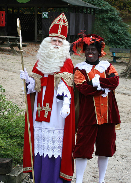 Saturn and his Satyr? Swarte Piet and Sint Niklas...