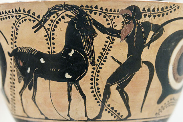 Black, bestial satyrs were the retinue of Dionysus in the DIonysia festival of ancient Greece. Image from an Attic vase 6th/5thC BCE.
