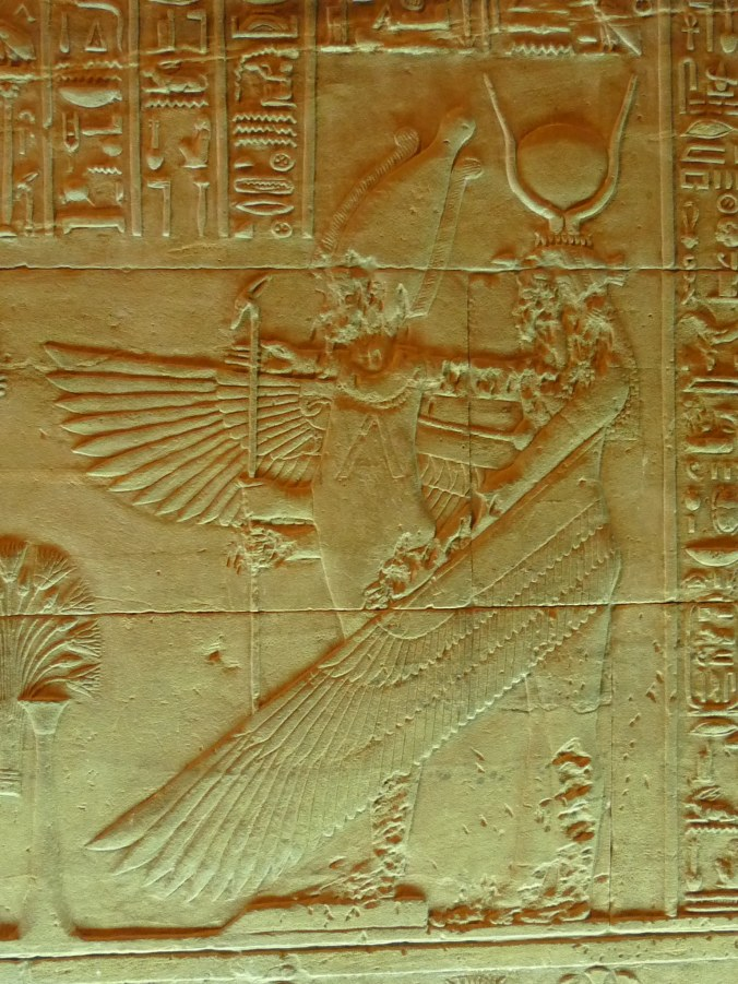 Bas relief image from Philae showing Isis resurrecting and embracing Osiris. Note the historic damage caused by Islamic iconoclasts.