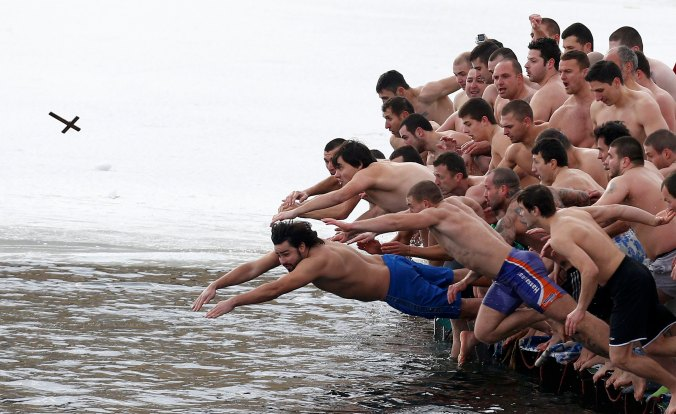 Bulgarian men 'diving for the cross' at Epiphany. Photo: Stoyan Nenov/Reuters