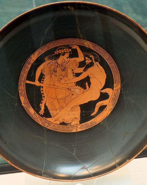 The wide shallow drinking Kylix offered the perfect mirror-surface. The Dionysian imagery in this example shows a female and male devotee of the Dionysian mysteries: a maenad and a satyr.