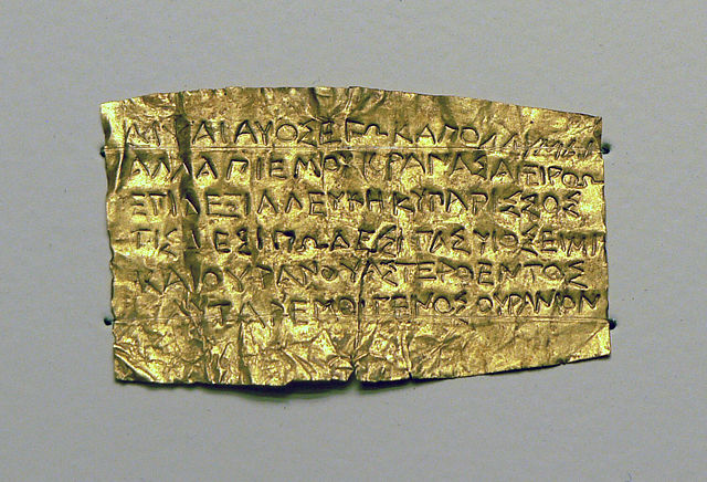 A 4thC BCE 'Orphic' gold tablet. The reflectivity of the tablet is broken up by the inscription....