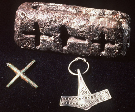 Thor's hammer and cross-pendants were associated with worship of a heroic sky-god in pagan and early-christian Scandinavia.